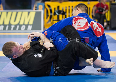Roberto Trejo X Jason Cattie in the Master 2, blue belt, middle quarter final.