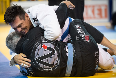 Nathan Camacho X Alexander Martinez in the Master 3, blue belt, middle quarter final.