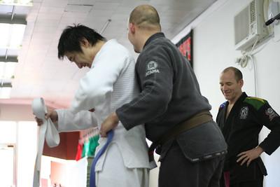 Jeau earns his Blue Belt in BJJ.