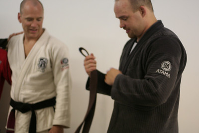 Jory putting on his well deserved Brown Belt in BJJ.