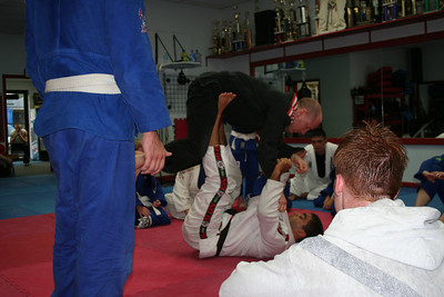 Shaolin demonstrates sweep to an armbar.