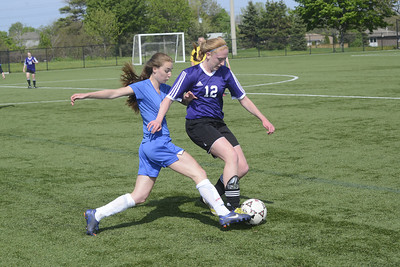 58004 OakSport BurlSport May 20 2014 Burlington Abbey Park Eagles vs Robert Bateman Wild in first-round playoff game of Halton high school senior girls soccer.	 Here, Abbey Park's #5 Emily Droppo and Bateman's #12 Eric Riehl/Metroland Media Group