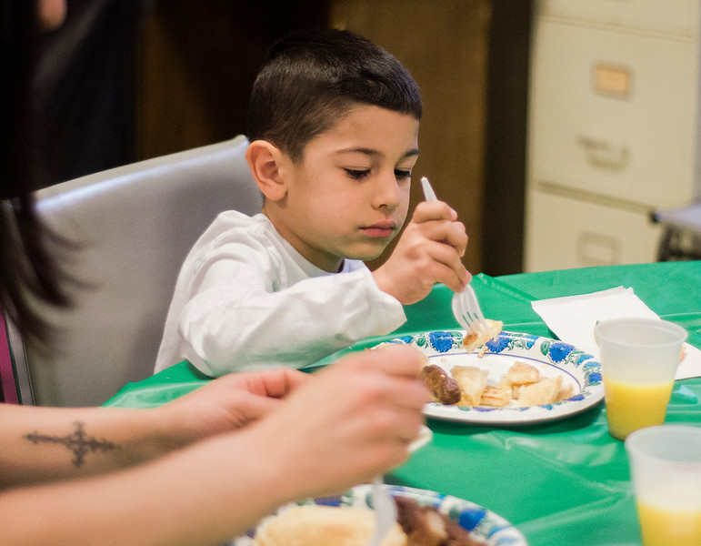 Ian Gonzalez, 5, enjoys some pancakes during the Breakfast with the Bunny at the Fitchburg Senior Center on Saturday, April 8, 2017. Proceeds from the event will go towards Fitchburg's annual Civic Days events. SENTINEL & ENTERPRISE / Ashley Green