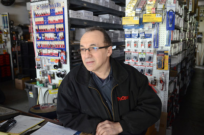 Ed Greco stands inside his Mount Carmel Store on Wednesday morning after it was struck and damaged by a dump truck carrying a load of coal.