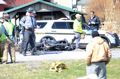 State Police and emergency personnel work the scene of a motorcycle accident Thursday on Forrest Hill Road in Front of Green Ridge Market in Mifflinburg.