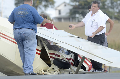 A small airplane lays on the end of a runway at the Penn Valley Airport after it crashed their on Friday afternoon.