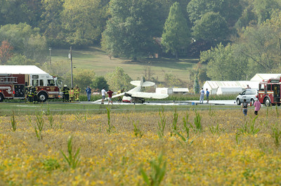 A small airplane lays with a crumpled nose on the runway at the Penn Valley Airport on Friday afternoon after it crashed there.