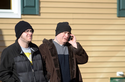 Fred Weaver talks on his phone while watching on as fire fighters spray water onto his home on White Deer Pike Thursday morning after it caught fire.