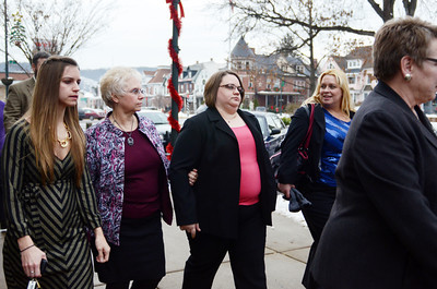 Colleen LaFerrara, second from right, the widow of murder victim Troy LaFerrara, leaves the Northumberland County Courthouse along with other members of her family and Sunbury Corporal Jamie Quinn, far right, after the preliminary hearings for Miranda and Elytte Barbour on Friday afternoon in Sunbury.