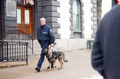 Sunbury Police Officer Scott Hause walks the perimiter of the Northumberland County Courthouse with the K-9 officer on Friday morning before the preliminary hearings of Miranda and Elytte Barbour for the alleged murder of Troy LaFerrara.