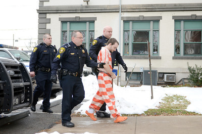 Elytte Barbour is led into the Northumberland County Courthouse for his preliminary hearing for the alleged murder of Troy LaFerrara on Friday morning in Sunbury.