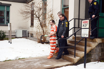 Elytte Barbour is led out of the Northumberland County Courthouse on Friday afternoon after his preliminary hearing in the murder of Troy LaFerrara. Barbour plead not guilty and will face trial next year.