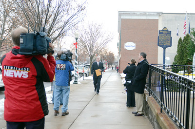 Jim Kelley, Northumberland County Coroner, walks to the Northumberland County Courthouse surronded by members of the media on Friday morning for the preliminary hearings of Miranda and Elytte Barbour.