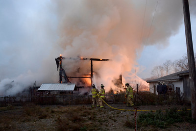 Fire fighters work to extinguish a large barn fire Thursday evening on Route 54 just outside of Turbotville.