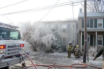Cold weather was a factor in fighting a fire on Tuesday on Ash Street in Danville as ice formed almost everywhere the water touched.