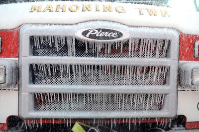Icicles cling to a Mahoning Township fire truck on Tuesday during a house fire on Ash Street in Danville.