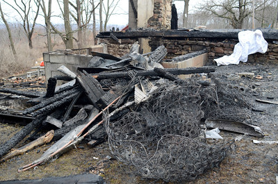 Only a few charred and destroyed contents remained from a house fire early on Friday morning at 60 S. Smith Road in Rush Township.
