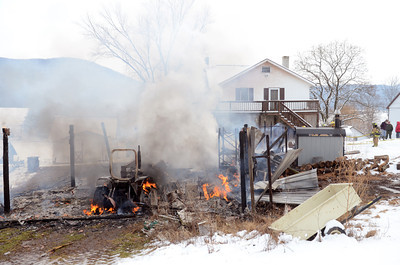 A barn fire endangered a home on State Road in Dornsife on Tuesday afternoon destroying the barn and everything in it.