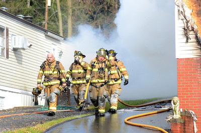 Fire fighters move to a different location to battle a blaze on Duke Street in Point Township on Thursday morning that consumed a home.