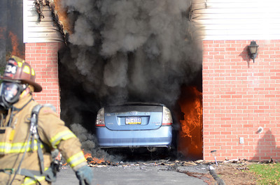 Flames consume the garage and Prius in the garge as it spreads to the rest of the home at 2058 Duke Street in Point Township on Thursday morning.