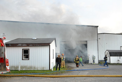 Smoke rises out of a Kuhns Brothers fire wood division building in Snyder County after a fire broke out their on Wednesday evening.