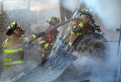 Firefighters from eight companies work together to battle a fire at Kuhns Brothers' Log Homes in Lewisburg Thursday Aug. 30, 2012.