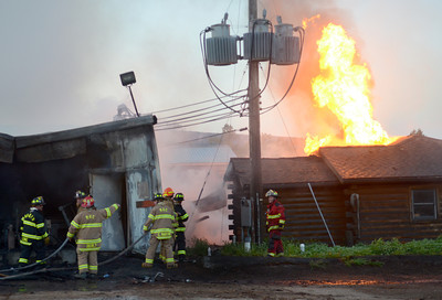 Firefighters from eight companies in Union, Snyder and Northumberland Counties worked to extiguish a fire at Kuhns Brothers' Log Homes in Lewisburg Thursday Aug. 30, 2012.