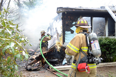 Fire fighters work to control a house fire that happened Wednesday afternoon in Point Township.