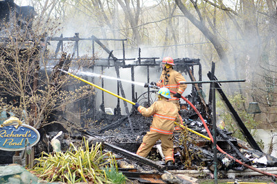 Fire fighters put out hot spots at a fire in Point Township on Wednesday afternoon.