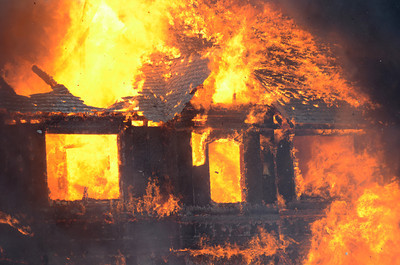 Flames completely engulf a home at 200 Dogwood Road in Point Township on Monday afternoon.