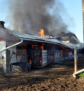 Harry Deitz/For The Daily Item Firefighters respond Saturday evening to a barn fire along Route 890 in Rockefeller Township, Northumberland County. Additional information was not available at deadline.
