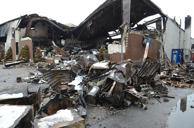 Some of the rubble still standing as of Monday morning at Kellers Marine in Port Trevorton from Friday's fire.