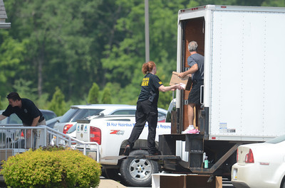 Files from Minuteman Environmental Services in Milton are loaded into the back of a truck on Wednesday morning.