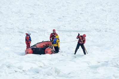 Fire fighters search the Susquehanna River north of Port Trevorton on Wednesday afternoon after a person called in reporting someone was walking on the ice.