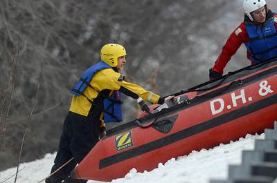 Emergency personnel lower a rescue boat down an embankment along Route 11&15 north of Port Trevorton on Wednesday afternoon while searching for a individual in the Susquehanna River.