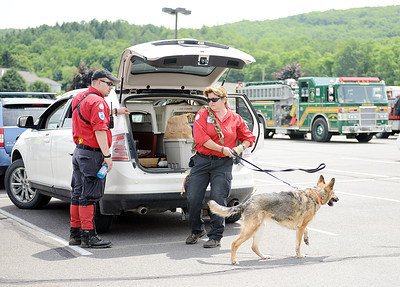 A canine Search and Rescue team prepares to search for Mackenzie Greco, who dissparead from Mount Carmel Township on Monday night, at the temporary command base at the Mount Carmel Area High School on Tuesday afternoon.