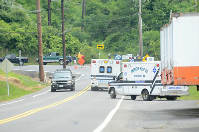 Ambulances arrive on the scene of a shooting on Tuesday afternoon on Mile Post Road.