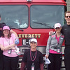 With a firetruck AND 2 firemen!!!!   They were such good sports!!   (The special team)<br /> <br /> Our team consisted of:  Shelly Rohde, Kim Fitz Gerald, Tommie Price, and Jeri Haubiel