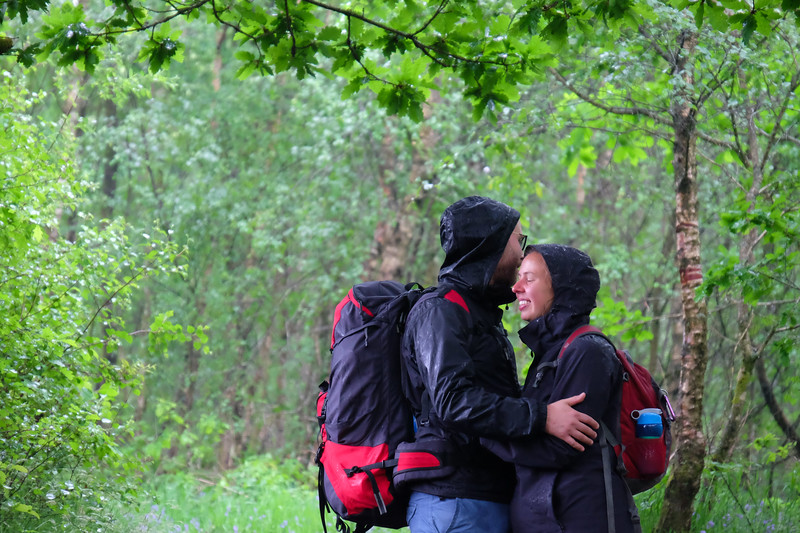 embrace in the rain