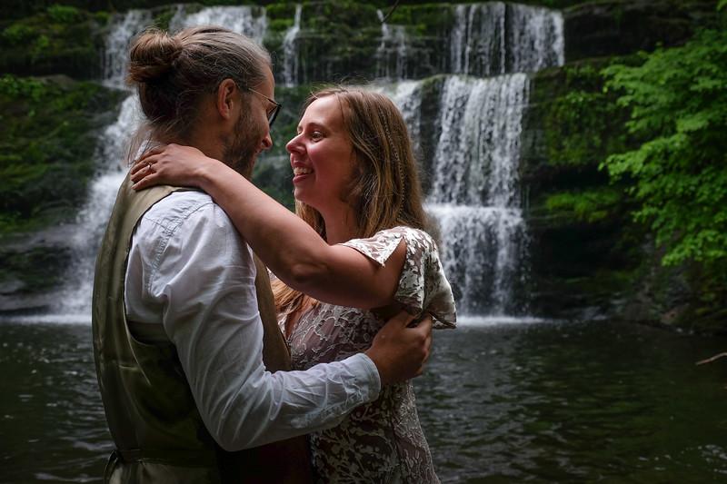 white waterfall engagement couple