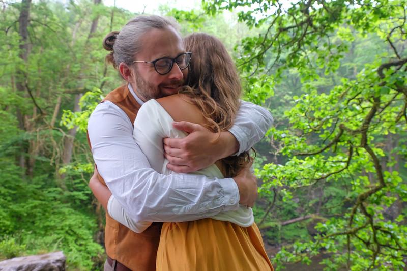 Engaged couple hug