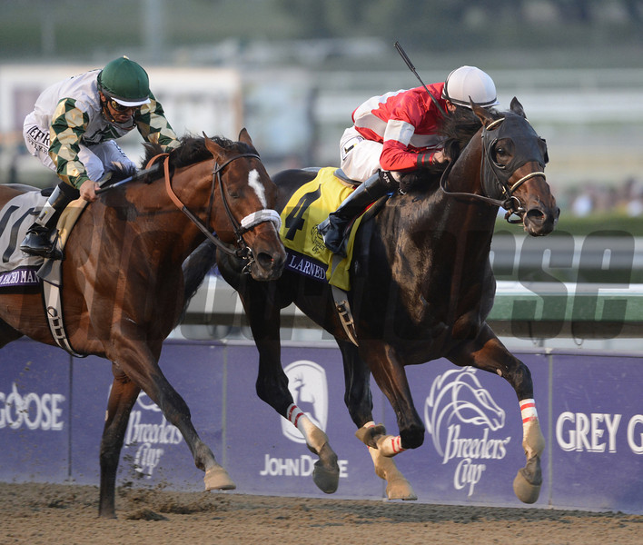 Shanghai Bobby with jockey Rosie Napravnik beats out #3 He's Had Enough with jockey Mario Gutierrez to the wire to win The Breeders' Cup Juvenile at Santa Anita Park in Arcadia, California November 3, 2012. <br /> Photo by Skip Dickstein
