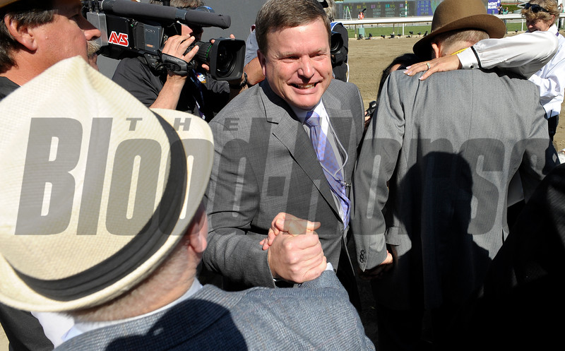 Caption: Buff Bradley receives congratulations right after win, trackside. Groupie Doll with Rajiv Maragh wins the Filly and Mare Sprint<br /> Breeders' Cup races at Santa Anita near Arcadia, California, on Nov. 3, 2012.<br /> BCRACES2012        FillyMareSprint   image<br /> Photo by Anne M. Eberhardt