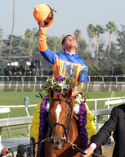 Javier Castellano celebrates aboard Zagora after winning the Breeders' Cup Filly & Mare Turf at Santa Anita Park on November 2, 2012.<br /> Photo by Chad Harmon