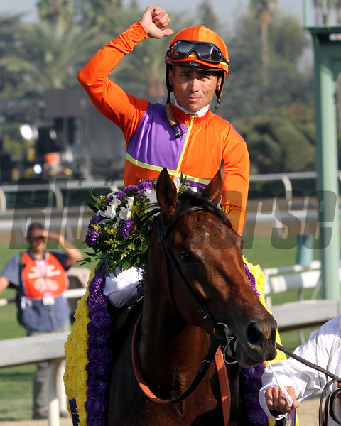 Garrett Gomez celebrates aboard Beholder after winning the Breeders' Cup Juvenile Fillies at Santa Anita Park on November 2, 2012.<br /> Photo by Chad Harmon