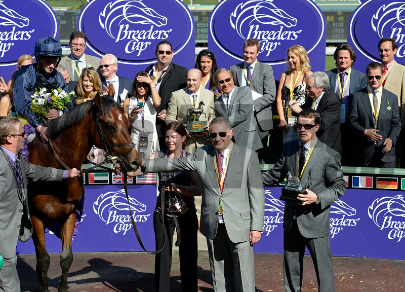 Caption: George Vancouver with Ryan Moore wins the Juvenile Turf, co owner Derrick Smith holds the horse (center) with trainer Aidan O'Brien on right<br /> Breeders' Cup races at Santa Anita near Arcadia, California, on Nov. 3, 2012.<br /> BCRACES2012         JUVTurf   image<br /> Photo by Anne M. Eberhardt