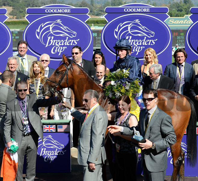 Caption: George Vancouver with Ryan Moore wins the Juvenile Turf, with co-owner Derrick SMith holding horse and trainer Aidan O'Brien, at right<br /> Breeders' Cup races at Santa Anita near Arcadia, California, on Nov. 3, 2012.<br /> BCRACES2012         JUVTurf   image<br /> Photo by Anne M. Eberhardt