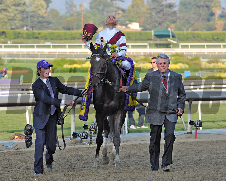 Owner Benjamin Leon, leads Royal Delta and jockey Mike Smith, to the winners circle, after winning the Breeders Cup Ladies' Classic at Santa Anita...