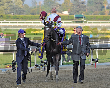 Owner Benjamin Leon, leads Royal Delta and jockey Mike Smith, to the winners circle, after winning the Breeders Cup Ladies' Classic at Santa Anita... © 2012 Rick Samuels/The Blood-Horse