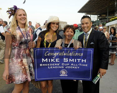 Caption: Mike Smith's mom, second right, and family/friends celebrate Mike's wins as leading jockey.  Royal Delta with Mike Smith wins the Ladies Classic.  Breeders' Cup races at Santa Anita near Arcadia, California, on Nov. 2, 2012. BCRACES2012          Ladies Classic2    image736 Photo by Anne M. Eberhardt